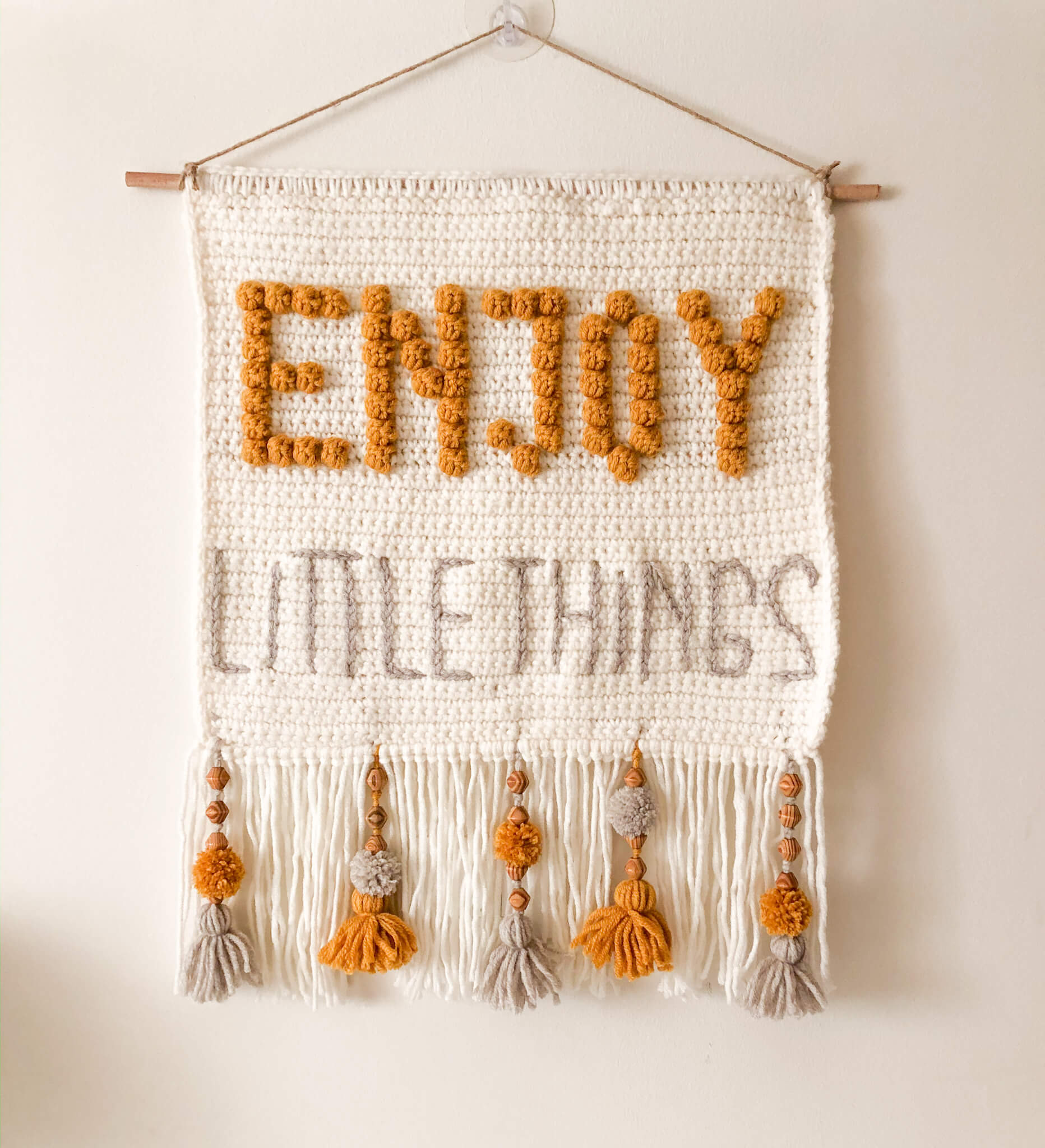 """ENJOY LITTLE THINGS"" CROCHET WALL HANGING"